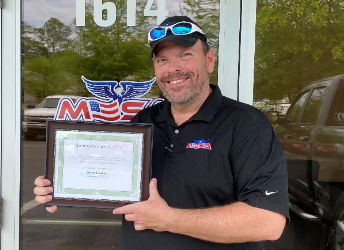 """Brian Hopkins was awarded a prestigious """"Packing our Parachutes"""" Certificate of Appreciation Award"""